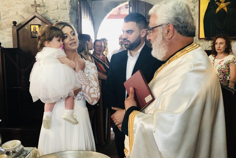 The Godparents, The Child & The Priest